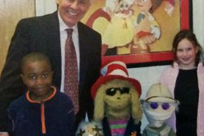 Color photograph of Larry Burke, principal of Union Mill from 2006 to 2008. He is standing with a pair of students.