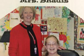 Color photograph of Susan Shandis, principal of Union Mill from 2008 to 2011. She is standing behind a smiling student.